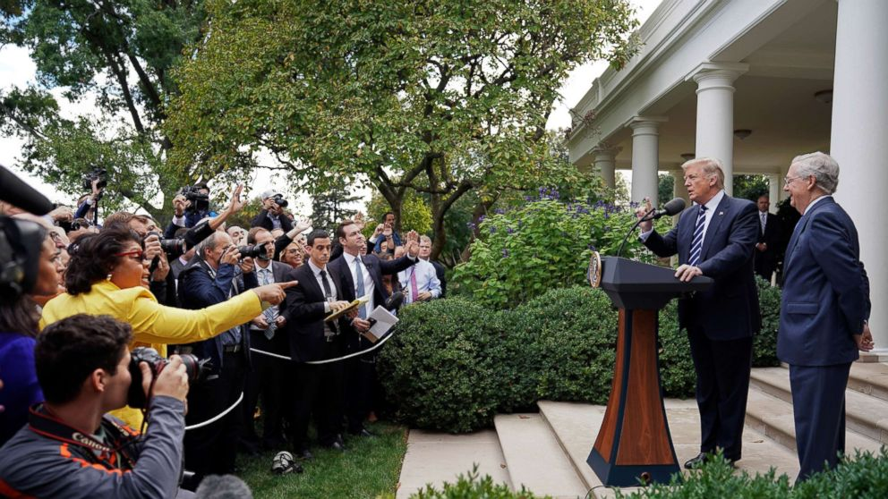 The Washington bureau chief for American Urban Radio Networks gestures as she asks questions to President Donald Trump and Senate Majority Leader Mitch McConnell of Ky., in the Rose Garden of the White House, Oct. 16, 2017.