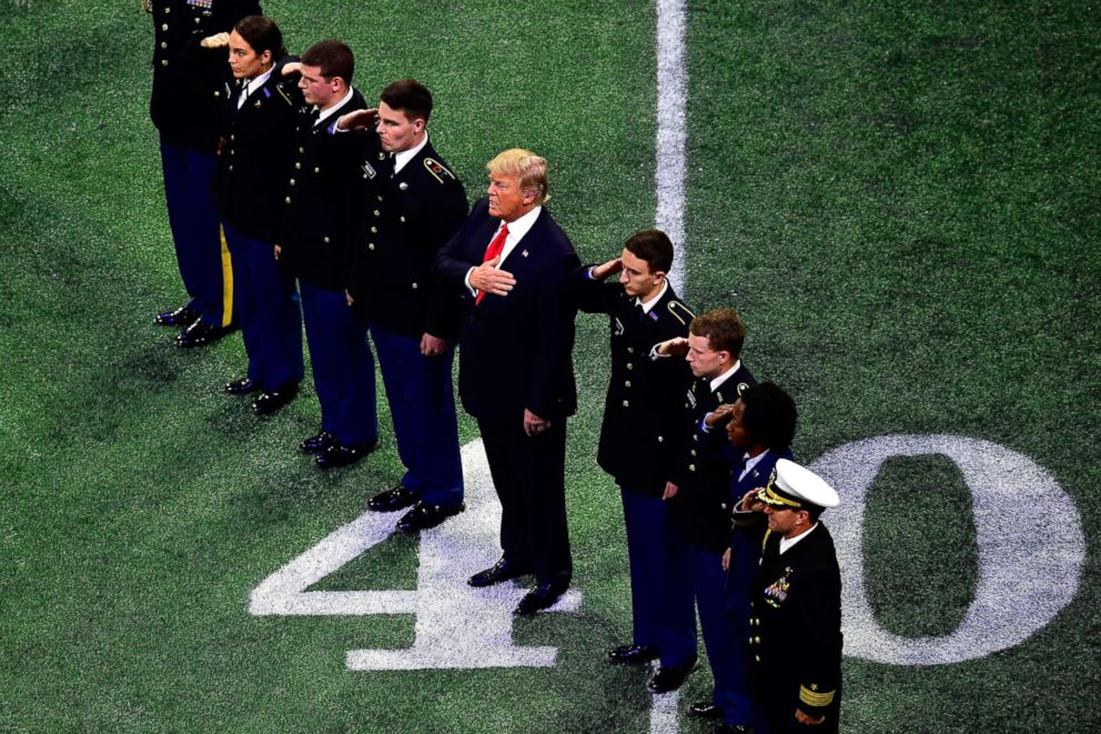 PHOTO: President Donald Trump on the field during the national anthem prior to the CFP National Championship presented by AT&T between the Georgia Bulldogs and the Alabama Crimson Tide at Mercedes-Benz Stadium in Atlanta, Jan. 8, 2018.