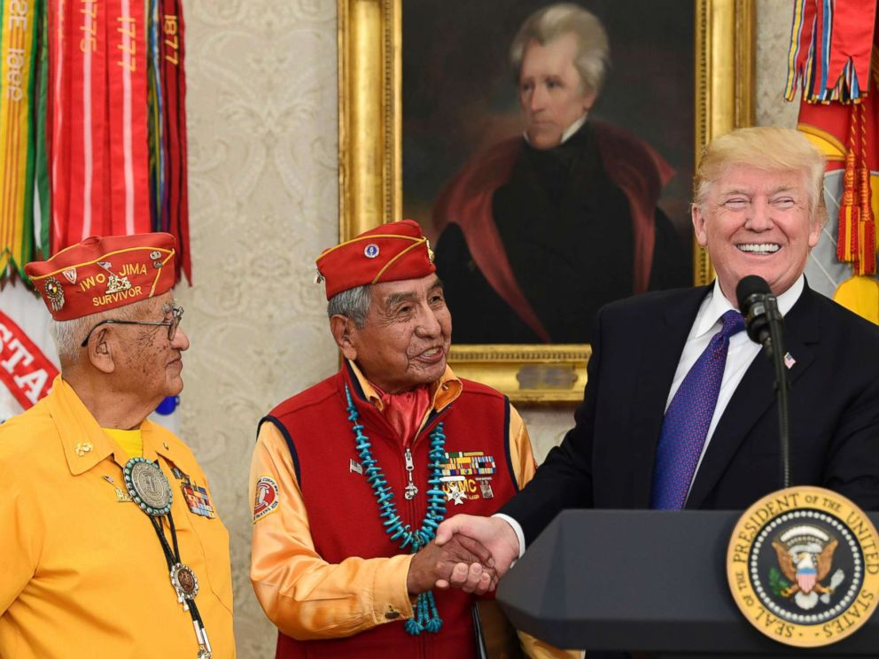 PHOTO: President Donald Trump, right, meets with Navajo Code Talkers Peter MacDonald, center, and Thomas Begay, left, in the Oval Office of the White House in Washington, Nov. 27, 2017.