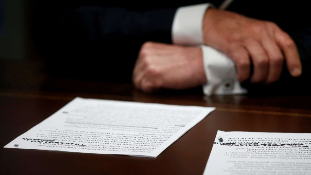 """President Donald Trump's prepared remarks show his own handwritten note """"There was no collusion"""" as he speaks about his summit meeting with Russian President Vladimir Putin at the start of a meeting with members of the U.S. Congress at the White House in Washington, July 17, 2018."""