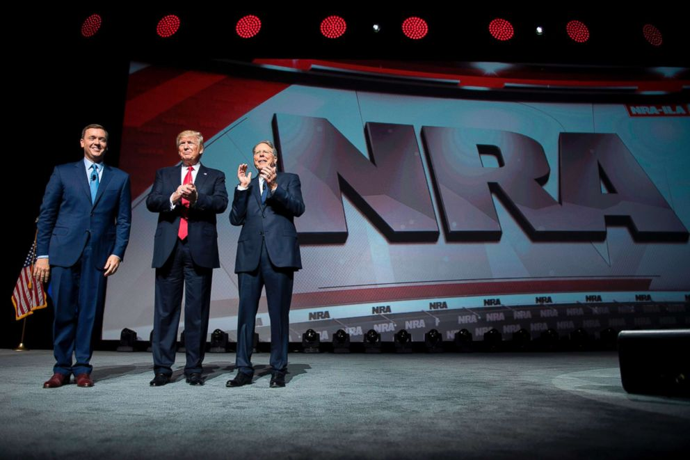 PHOTO: President Donald Trump stands with National Rifle Association (NRA) President Wayne LaPierre (R) and NRA-ILA Executive Director Chris Cox (L) during the NRA Leadership Forum in Atlanta, April 28, 2017.