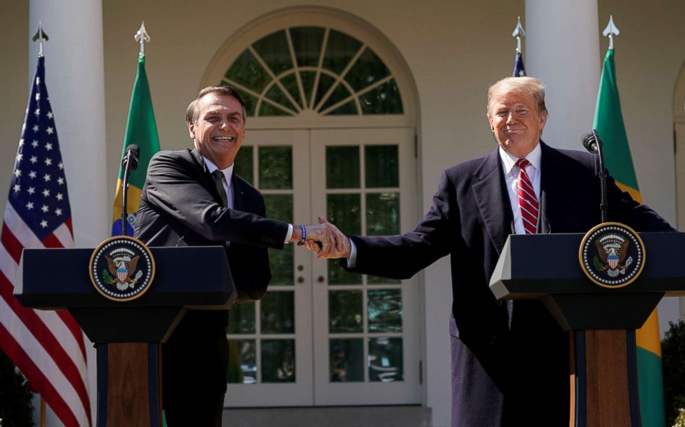 Brazil's President Jair Bolsonaro shakes hands with President Donald Trump at the conclusion of a joint news conference in the Rose Garden of the White House in Washington, March 19, 2019.