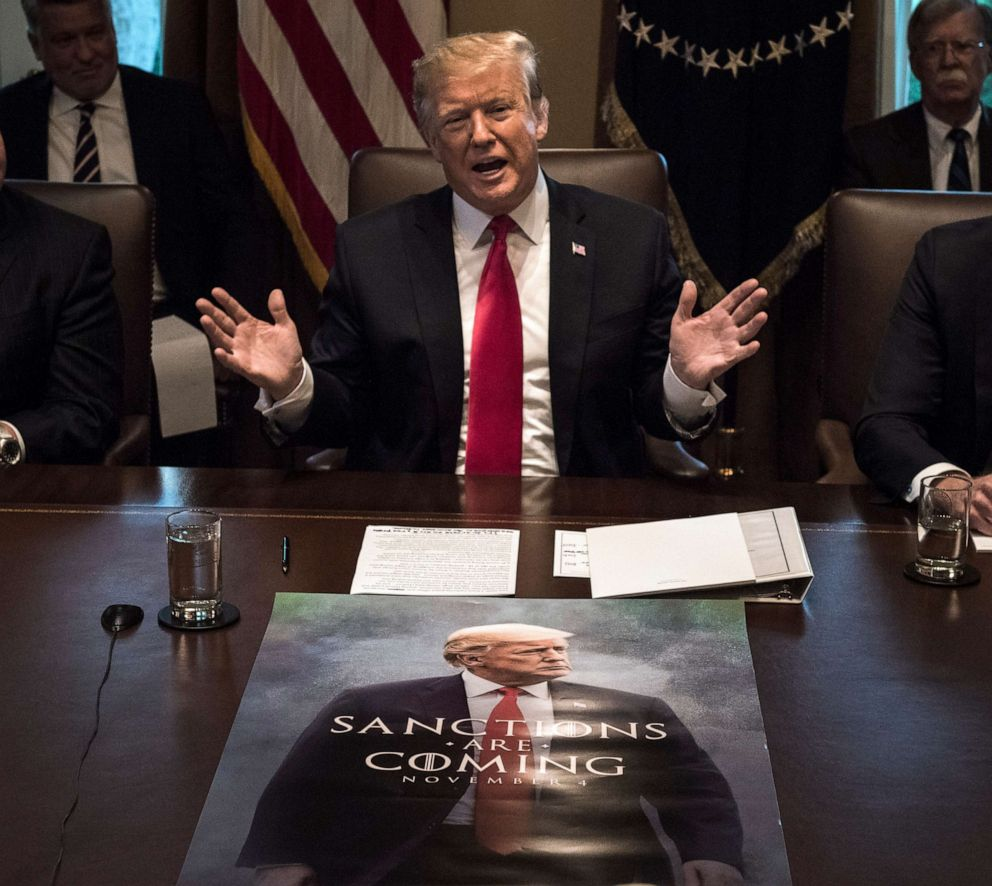 PHOTO: President Donald Trump leads a meeting of his Cabinet with a poster featuring him spread out on the conference table on Jan. 02, 2019, in Washington.