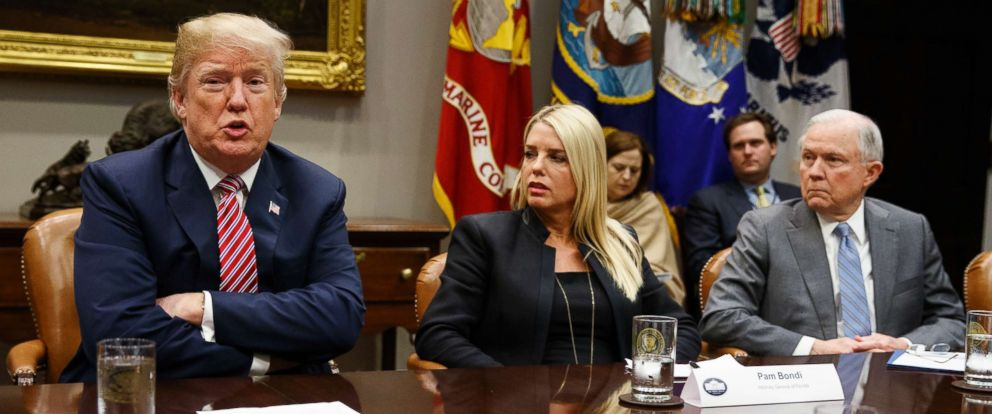PHOTO: Florida Attorney General Pam Bondi, center, and Attorney General Jeff Sessions, right, look on as President Donald Trump speaks during a meeting with state and local officials to discuss school safety, Feb. 22, 2018, in Washington.