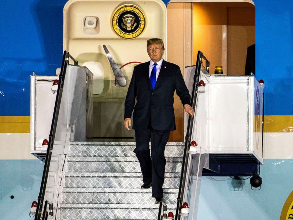 PHOTO: President Donald Trump walks off Air Force One as he arrives at the Paya Lebar Air Base in Singapore, June 10, 2018.