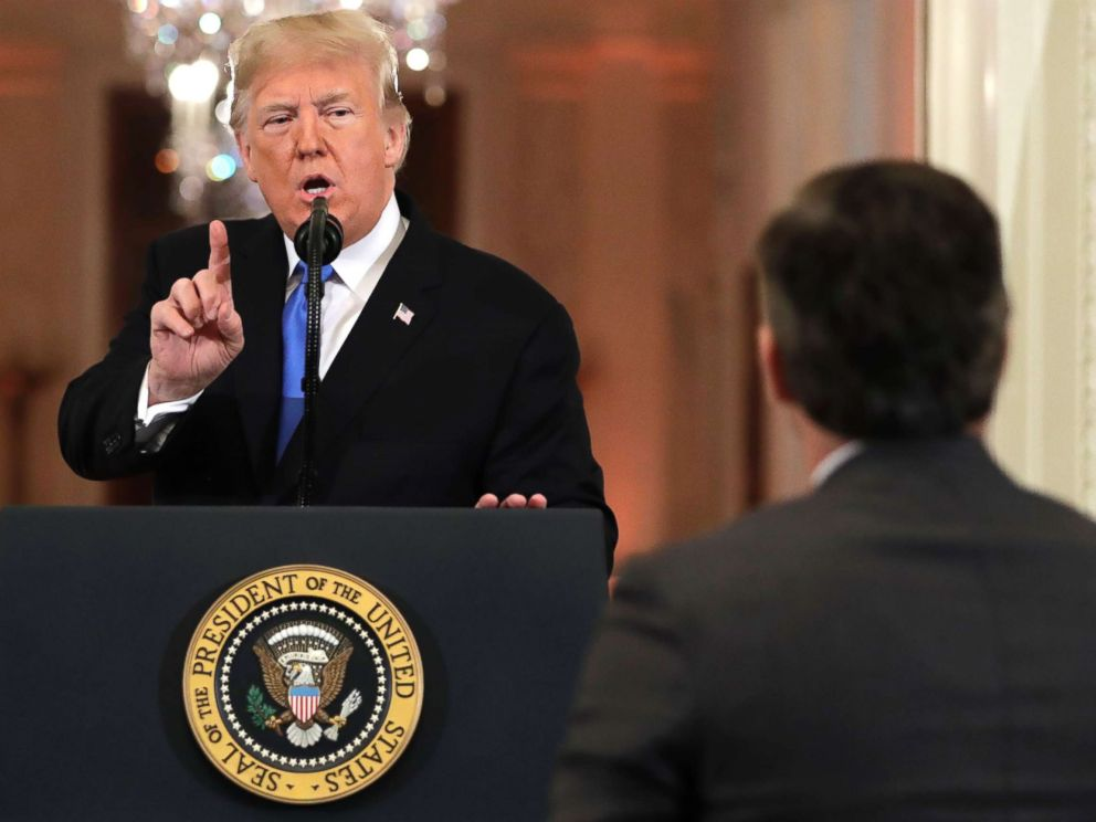PHOTO: President Donald Trump speaks as CNNs Jim Acosta, standing at right, listens, during a news conference in the East Room of the White House, Nov. 7, 2018, in Washington.