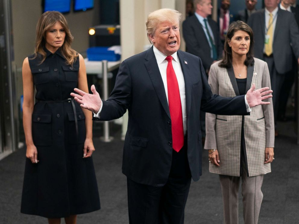 PHOTO: President Donald Trump addresses members of the news media as he arrives with First lady Melania Trump, left, and Nikki Haley, the U.S. ambassador to the United Nations, Sept. 25, 2018.