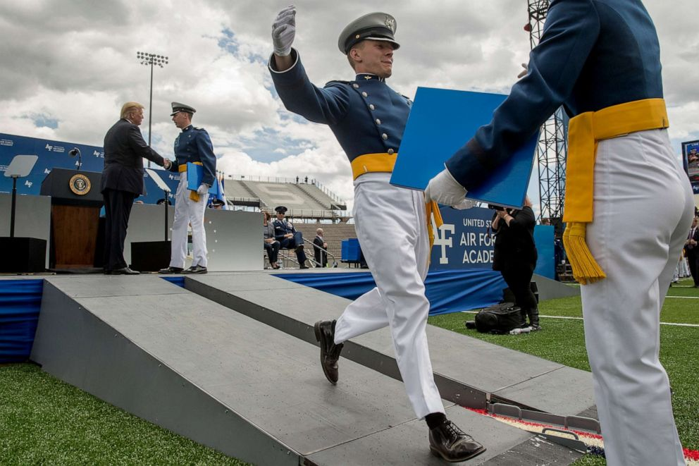 PHOTO: President Donald Trump greets cadets as they receive their diplomas during the 2019 United States Air Force Academy Graduation Ceremony at Falcon Stadium, May 30, 2019, in Colorado Springs, Colo.