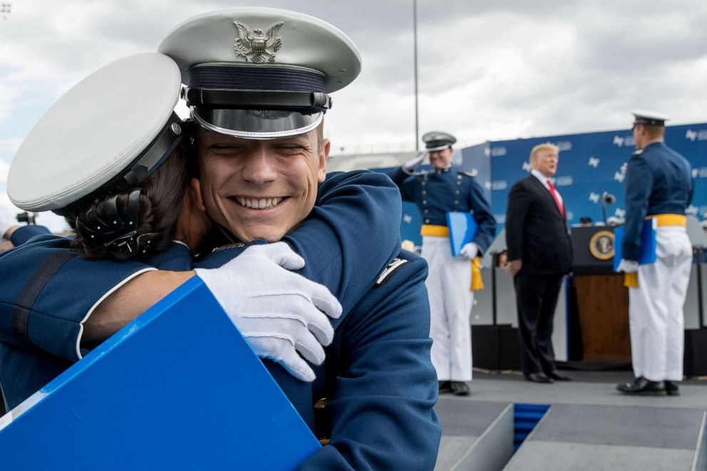 PHOTO: Cadets celebrate as they receive their diplomas and shake hands with President Donald Trump during the 2019 United States Air Force Academy Graduation Ceremony at Falcon Stadium, May 30, 2019.