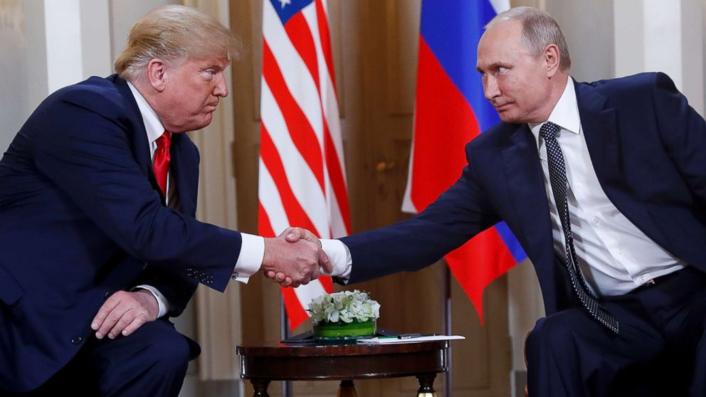 President Donald Trump, left, and Russian President Vladimir Putin, right, shake hands at the beginning of a meeting at the Presidential Palace in Helsinki, Finland, July 16, 2018.