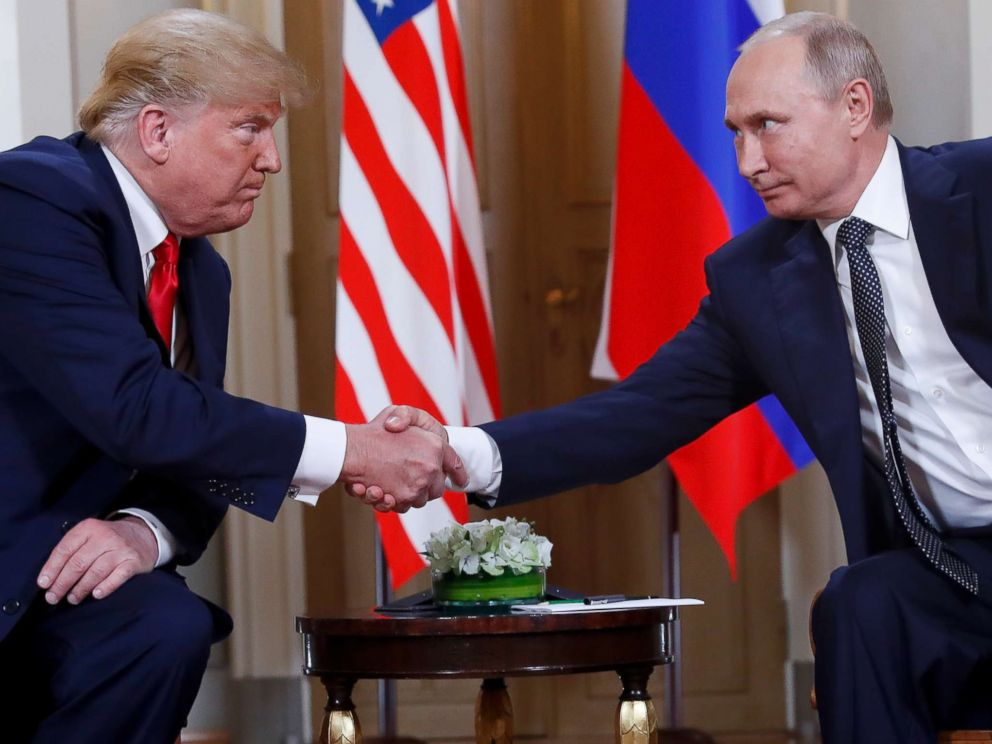 PHOTO: President Donald Trump, left, and Russian President Vladimir Putin, right, shake hands at the beginning of a meeting at the Presidential Palace in Helsinki, Finland, July 16, 2018.