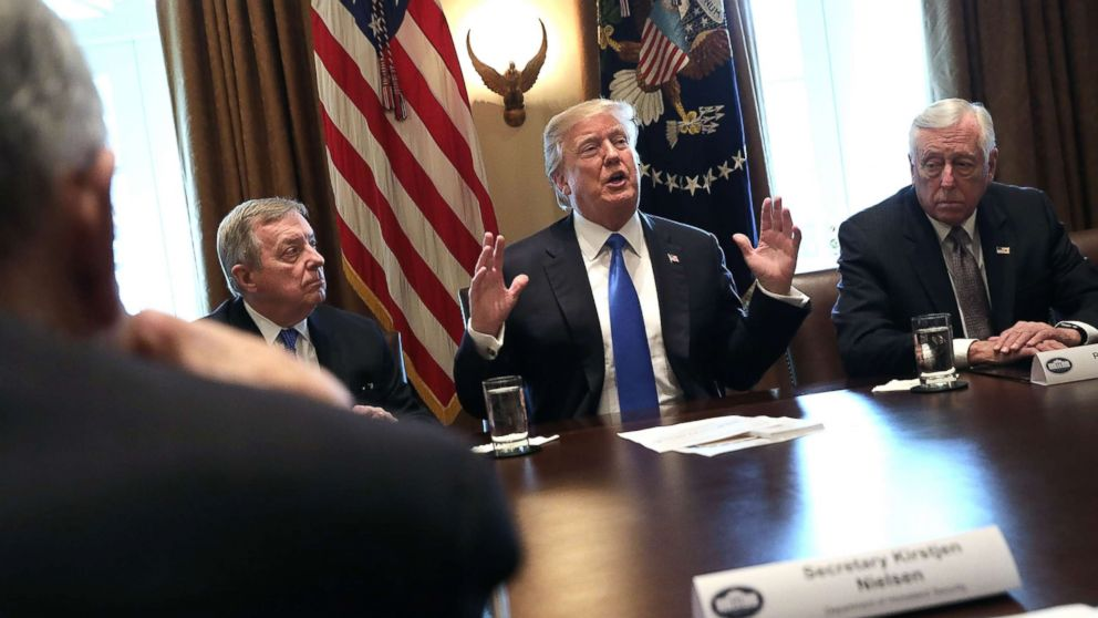 President Donald Trump (C) presides over a meeting about immigration with Republican and Democrat members of Congress, including Senate Minority Whip Richard Durbin (D-IL) (L) and House Minority Whip Steny Hoyer (D-MD) in the Cabinet Room at the White House, Jan. 9, 2018, in Washington.