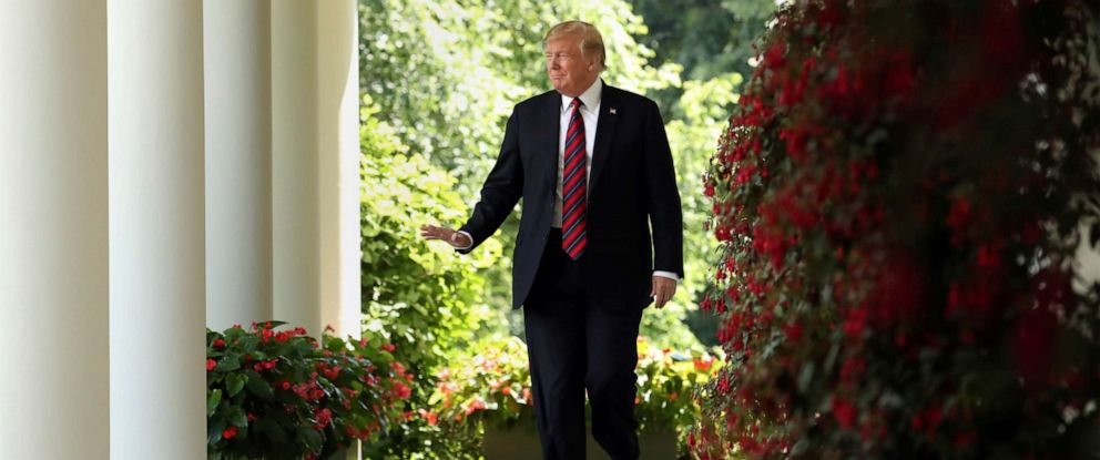 PHOTO: President Donald Trump walks from the Oval Office to speak on immigration in the Rose Garden at the White House, May 16, 2019, in Washington.