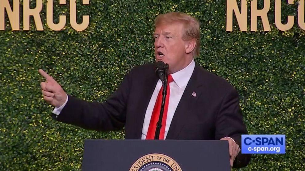 PHOTO: President Donald Trump mimics the movement of a windmill while delivering his speech at the NRCC Spring Dinner in Washington, April 2, 2019.