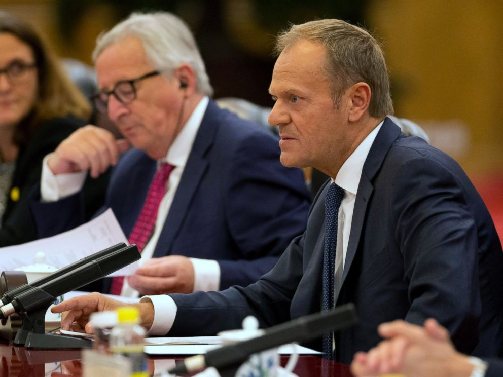 European Council President Donald Tusk, right speaks near European Commission President Jean-Claude Juncker during a meeting with Chinese Premier Li Keqiang, unseen at the Great Hall of the People in Beijing, China, Monday, July 16, 2018.