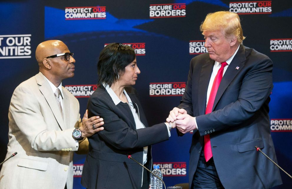 PHOTO: President Donald Trump embraces Evelyn Rodriguez whose daughter was killed by MS-13 gang members, alongside her husband Freddy Cuevas, during a roundtable discussion on immigration in Bethpage, New York, May 23, 2018.