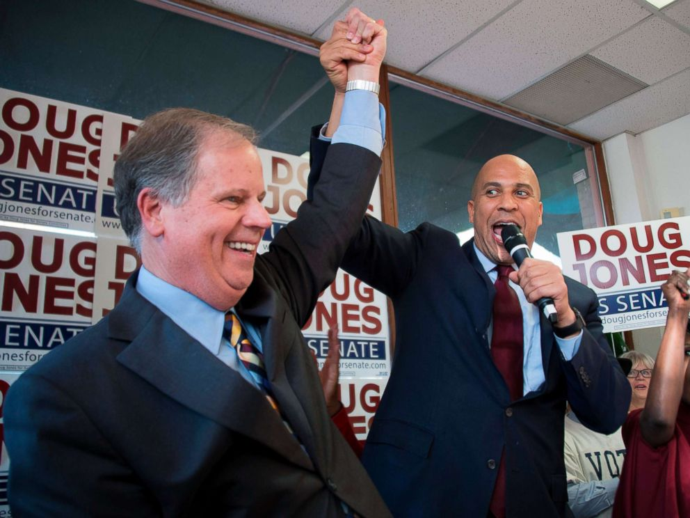 PHOTO: Senator Cory Booker raises the arm of Democratic Senatorial candidate Doug Jones while speaking at Jones campaign headquarters in Birmingham, Alabama, Dec. 10, 2017.