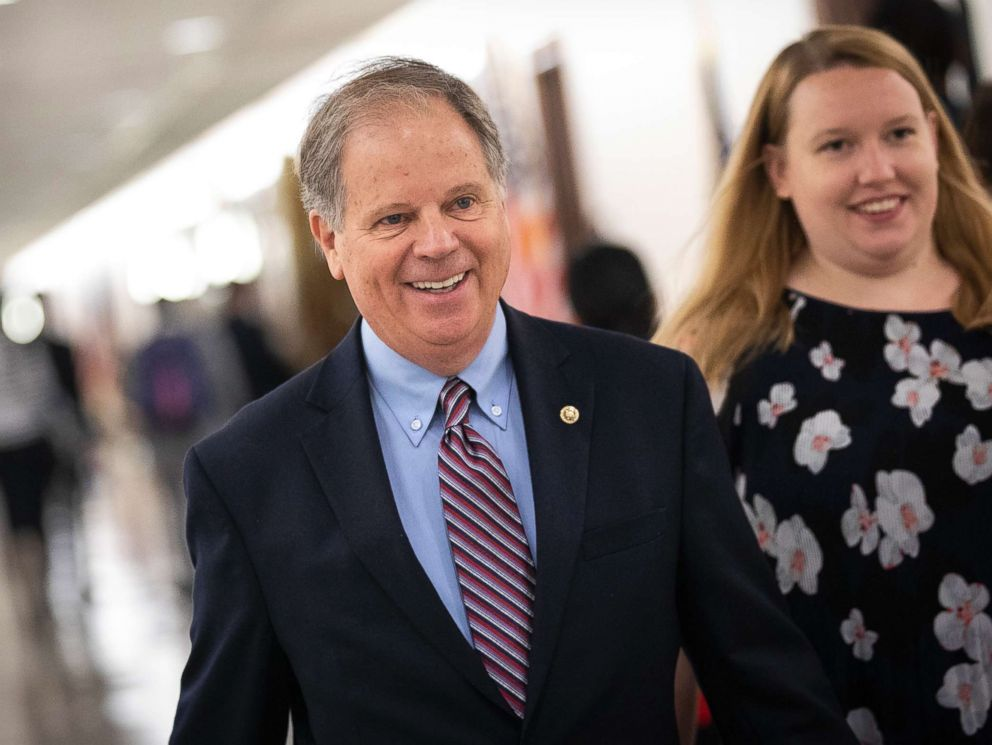 PHOTO: Sen. Doug Jones walks through the Dirksen Senate Office Building on Capitol Hill, Sept. 25, 2018 in Washington, D.C.