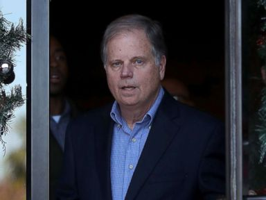 PHOTO: Democratic Senatorial candidate Doug Jones walks out of a campaign stop at Marthas Place, Dec. 11, 2017, in Montgomery, Alabama.