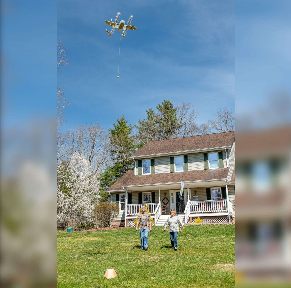PHOTO: A Virginia family receives an air delivery by drone as part of Wings validation testing with the FAA in an undated handout photo.