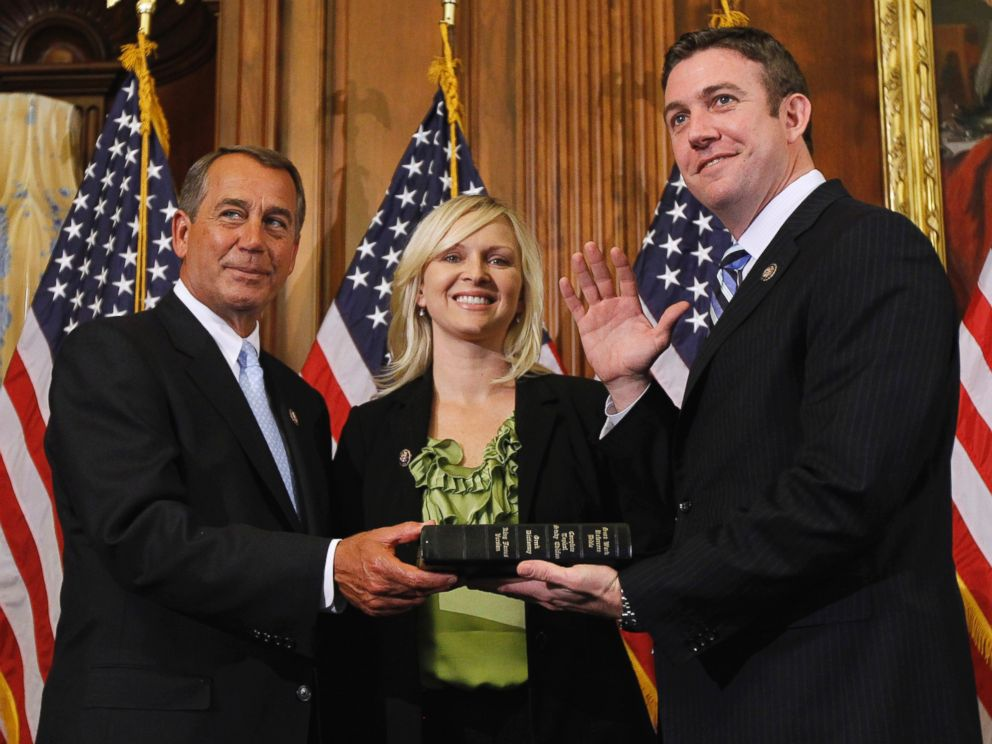 In this Jan. 5, 2011, file photo, House Speaker John Boehner of Ohio, left, administers the House oath to Rep. Duncan Hunter, R-Calif., as his wife, Margaret, looks on during a mock swearing-in ceremony on Capitol Hill in Washington.