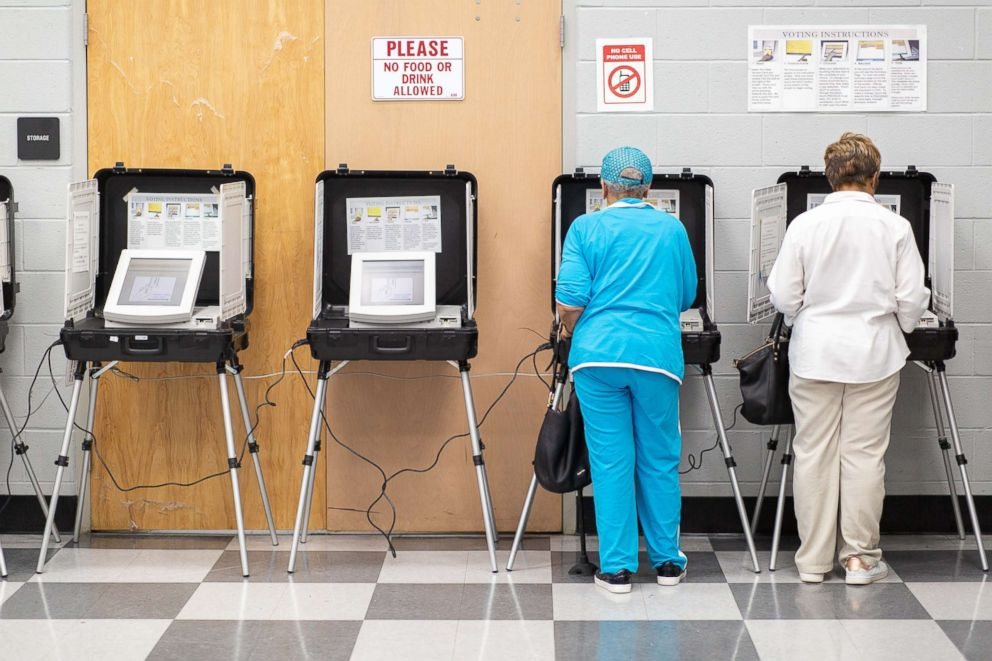 PHOTO: Voters cast ballots at a polling station open for early voting in the C.T. Martin Natatorium & Recreation Center in Atlanta, Oct. 16, 2018.