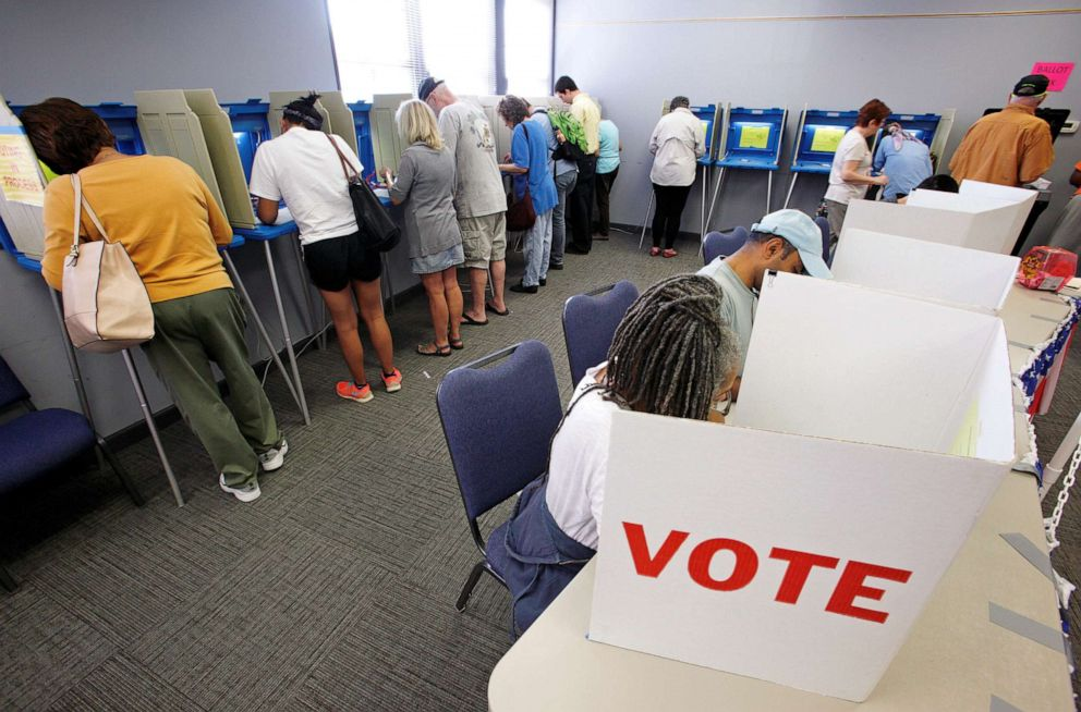PHOTO: In this Oct. 20, 2016, file photo, people cast their ballots for the 2016 general elections at a crowded polling station as early voting begins in Carrboro, N.C.