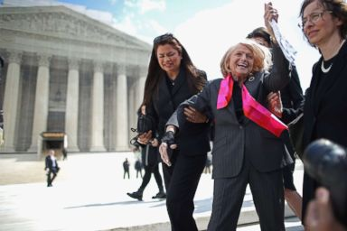 PHOTO: Edith Windsor, 83, acknowledges her supporters as she leaves the Supreme Court March 27, 2013 in Washington, DC.