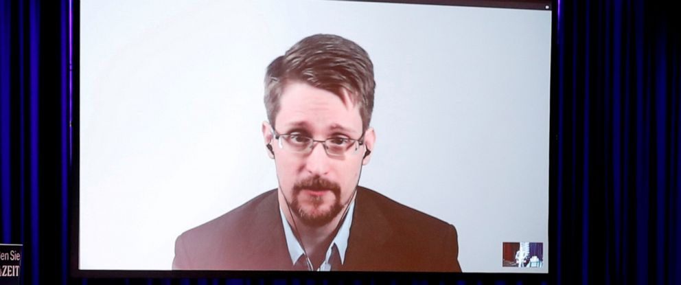 """PHOTO: Edward Snowden speaks via video link as he takes part in a discussion about his book """"Permanent Record"""" with German journalist Holger Stark in Berlin, Germany, September 17, 2019."""