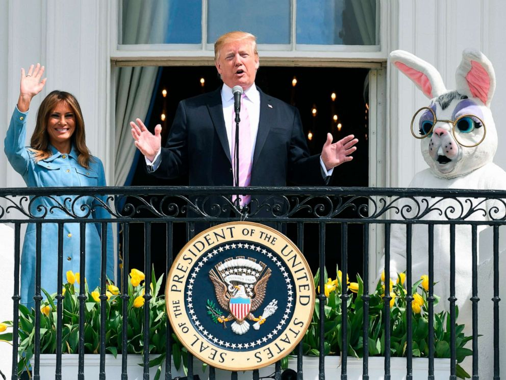 PHOTO: President Donald Trump speaks as First Lady Melania Trump waves during the annual White House Easter Egg Roll on the South Lawn of the White House, April 22, 2019.