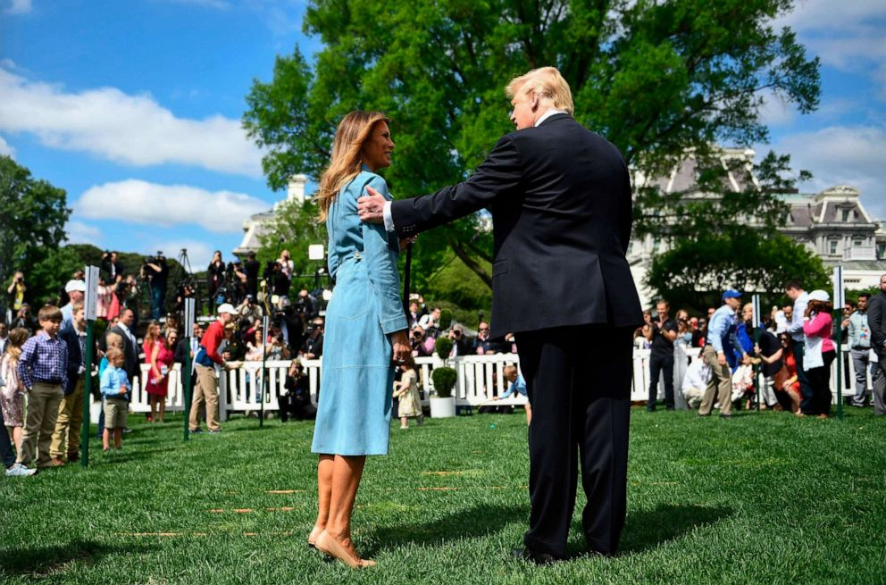 PHOTO:President Donald Trump holds the arm of First Lady Melania Trump during the annual White House Easter Egg Roll on the South Lawn of the White House, April 22, 2019.