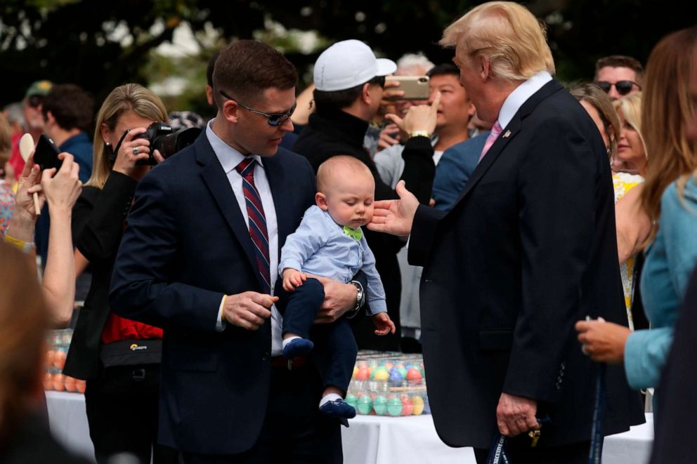 PHOTO:President Donald Trump, joined by first lady Melania Trump, right, greet guests on the South Lawn of the White House, April 22, 2019, during the annual White House Easter Egg Roll.