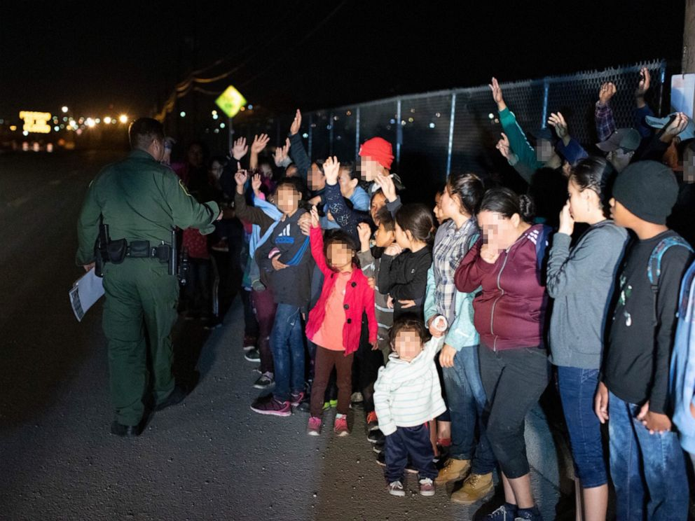 PHOTO: Migrants are seen lined up in El Paso, Texas, on March 23, 2019, after crossing the international border between the United States and Mexico and surrendering to a border patrol agent.