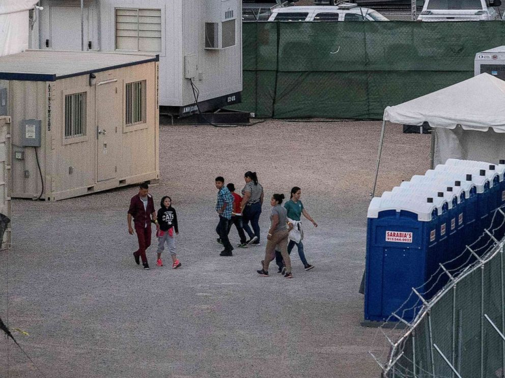 PHOTO: Immigrants held in a temporary facility set up to hold them at the El Paso Border Patrol Station, June 21, 2019.