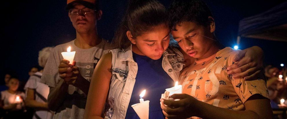 PHOTO: People hold candles as they pray during a candlelight vigil at the Immanuel Church for victims of a shooting that left a total of 22 people dead at the Cielo Vista Mall WalMart in El Paso, Texas, August 5, 2019.