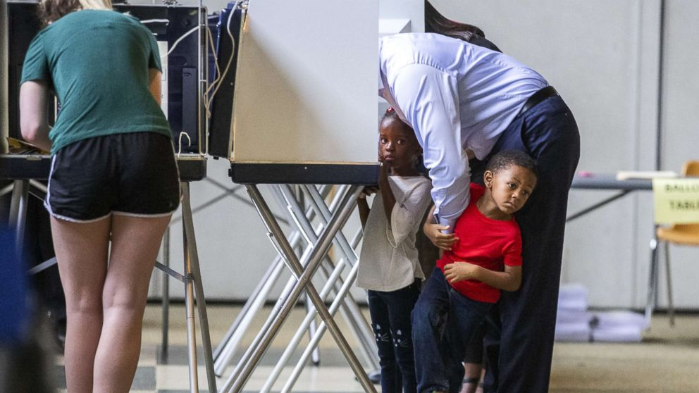 Tallahassee mayor and Democratic gubernatorial candidate Andrew Gillum casts his ballot with his four-year-old twins Caroline and Jackson on Nov. 6, 2018, in Tallahassee, Fla.