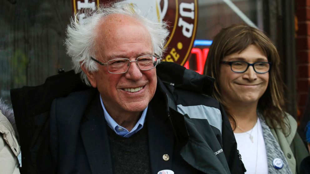 Sen. Bernie Sanders smiles as he poses for a photograph with Vermont Democratic gubernatorial candidate Christine Hallquist outside City Hall in Saint Albans, Vt., Nov. 6, 2018.