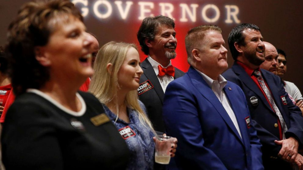 Brian Kemp supporters listen to a speaker as they wait for poll numbers to come in at Republican gubernatorial candidate Brian Kemp's election night party in Athens, Ga., Nov. 6, 2018.