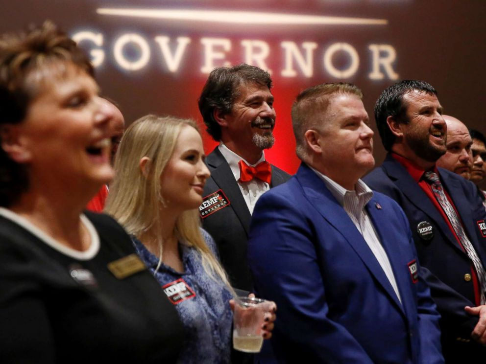 PHOTO: Brian Kemp supporters listen to a speaker as they wait for poll numbers to come in at Republican gubernatorial candidate Brian Kemps election night party in Athens, Ga., Nov. 6, 2018.