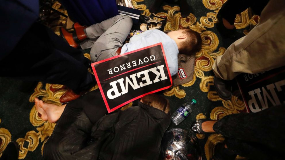 William Barrow, 8, of Griffin, Ga., sleeps early Wednesday morning, Nov. 7, 2018, during an election night party for Georgia Republican gubernatorial candidate Brian Kemp, in Athens Ga.