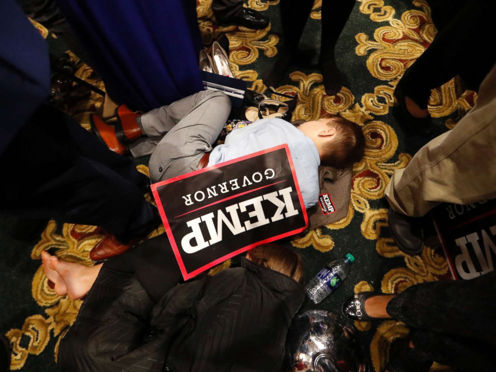 PHOTO: William Barrow, 8, of Griffin, Ga., sleeps early Wednesday morning, Nov. 7, 2018, during an election night party for Georgia Republican gubernatorial candidate Brian Kemp, in Athens Ga.