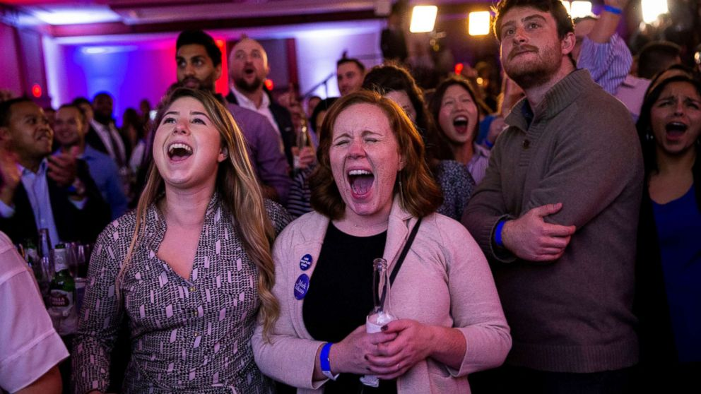 Alyssa Giammarella and Claire Viall cheer as they watch election results come in at a Democratic election night rally in Washington, Nov. 6, 2018.