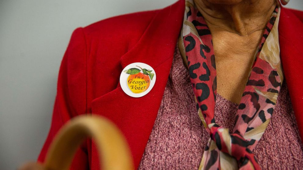 "A voter wears a sticker that reads ""I'm a Georgia Voter"" at a polling station in Atlanta, Ga., Nov. 6, 2018."