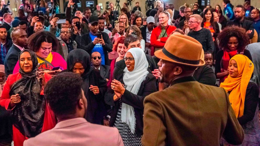 Supporters of Democratic congressional candidate, Ilhan Omar, center, celebrate  in Minneapolis, Nov. 6, 2018.