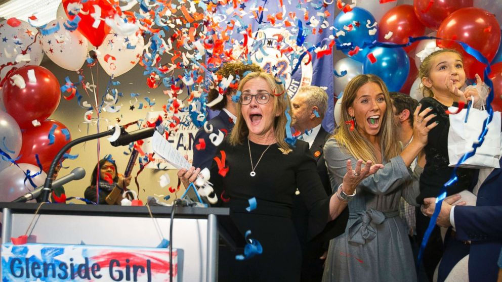 Democrat Madeleine Dean celebrates after winning Pennsylvania's 4th Congressional District race, in Fort Washington, Pa., Tuesday, Nov. 6, 2018.