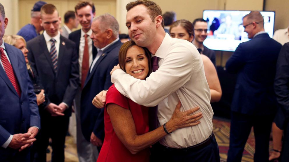 Republican Senate candidate Rep. Martha McSally greets voters in a holding room outside of her election night party in Phoenix, Nov. 6, 2018.