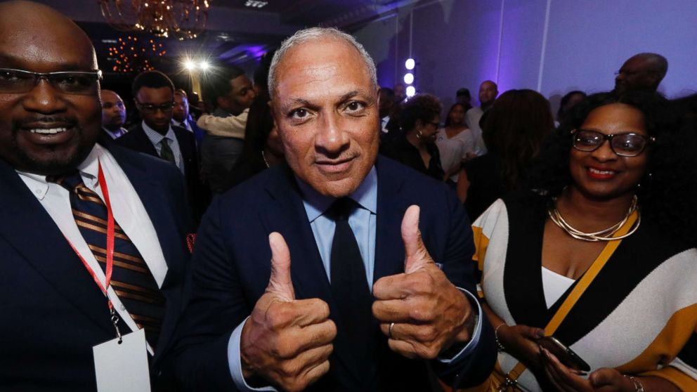 "Mike Espy who is seeking to unseat appointed Sen. Cindy Hyde-Smith and serve the last two years of the six-year term vacated when Republican Thad Cochran retired for health reasons, gives a ""thumbs up"" following his speech before a crowded ballroom in Jackson, Miss., Nov. 6, 2018."