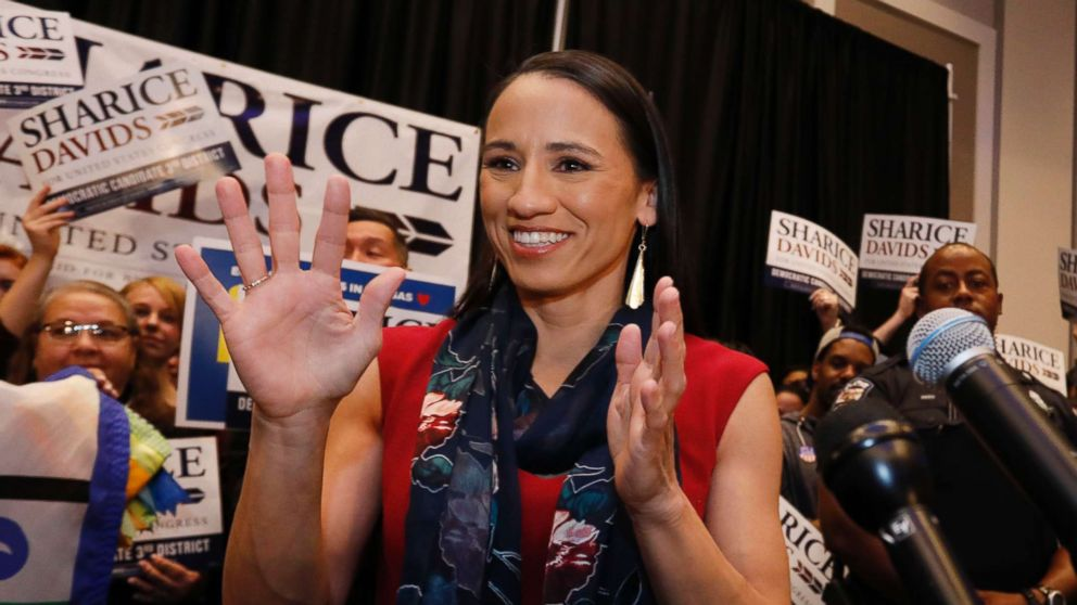 Democrat house candidate Sharice Davids reacts before speaking to supporters at a victory party in Olathe, Kan., Nov. 6, 2018.