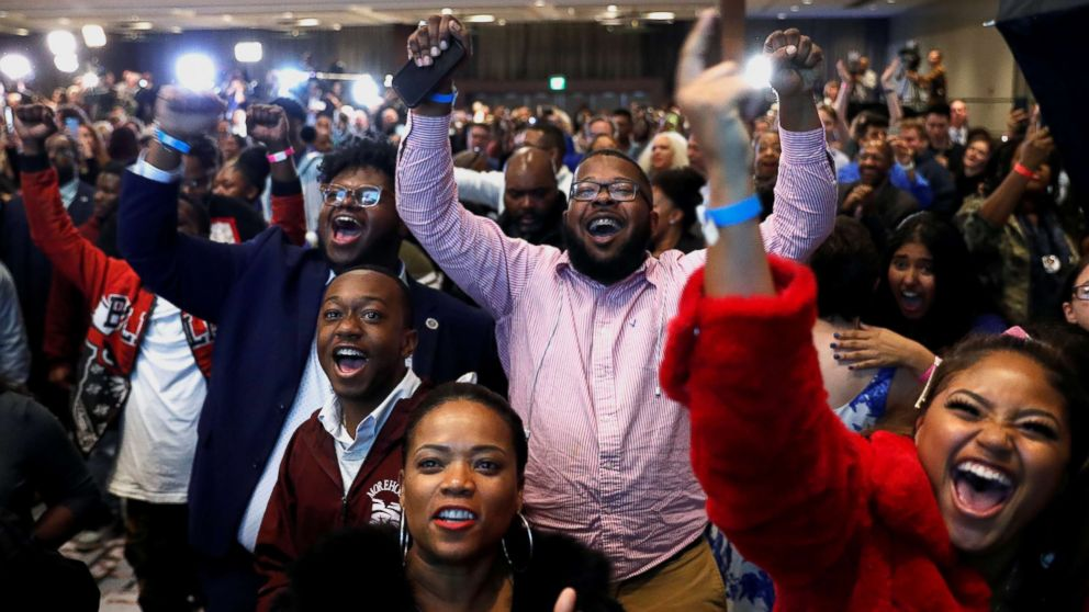 Supporters react after the Abrams campaign announced they were closing the gap during a midterm election night party for Georgia Democratic gubernatorial nominee Stacey Abrams in Atlanta, Nov. 6, 2018.