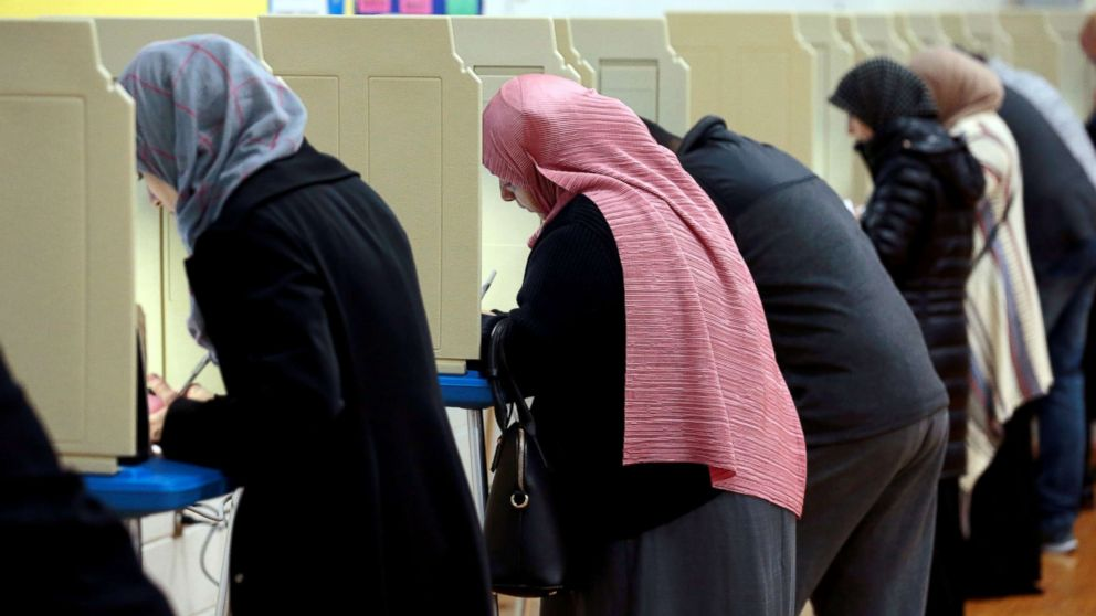 People cast their ballots in the midterm election at William Ford Elementary School in Dearborn, Mich., Nov. 6, 2018.